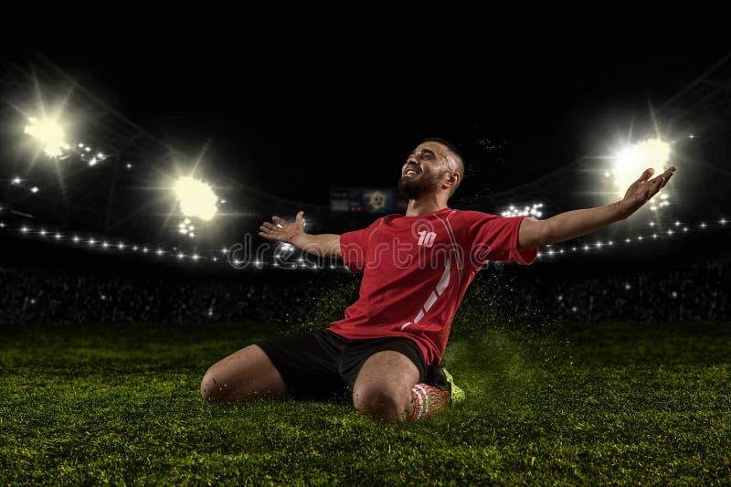 Gracz piłki nożnej świętuje goa na stadium obraz royalty free