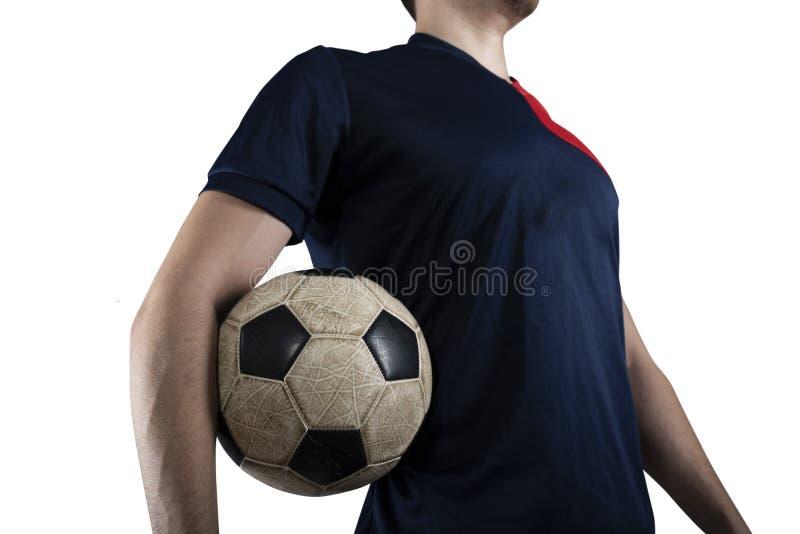 Gracz pi?ki no?nej z soccerball przygotowywaj?cym bawi? si? pojedynczy bia?e t?o zdjęcie royalty free