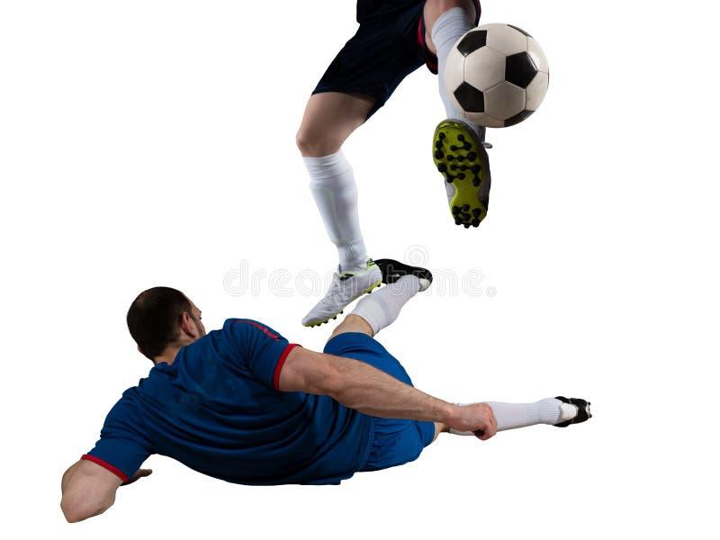 Gracze pi?ki no?nej z soccerball przy stadium podczas dopasowania pojedynczy bia?e t?o obrazy royalty free