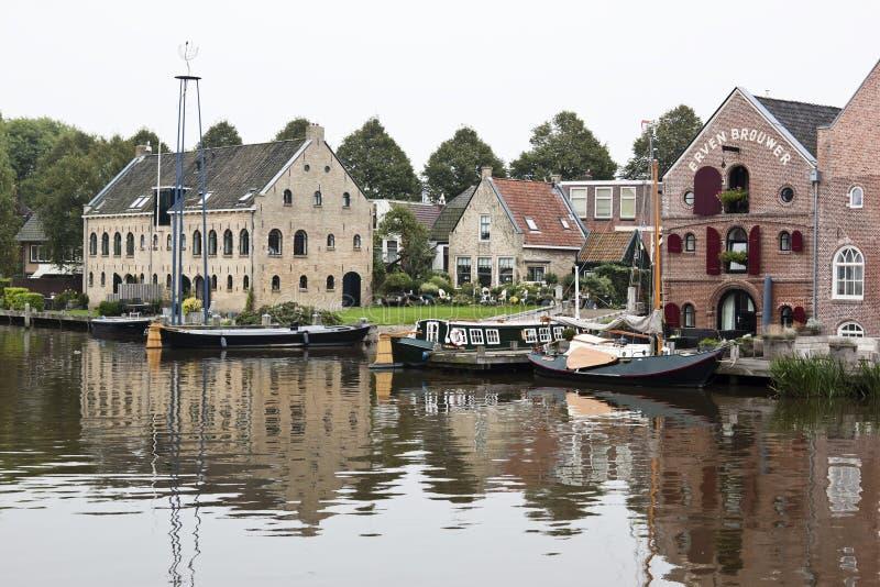 Grada y almacenes, Dokkum, los Países Bajos foto de archivo libre de regalías