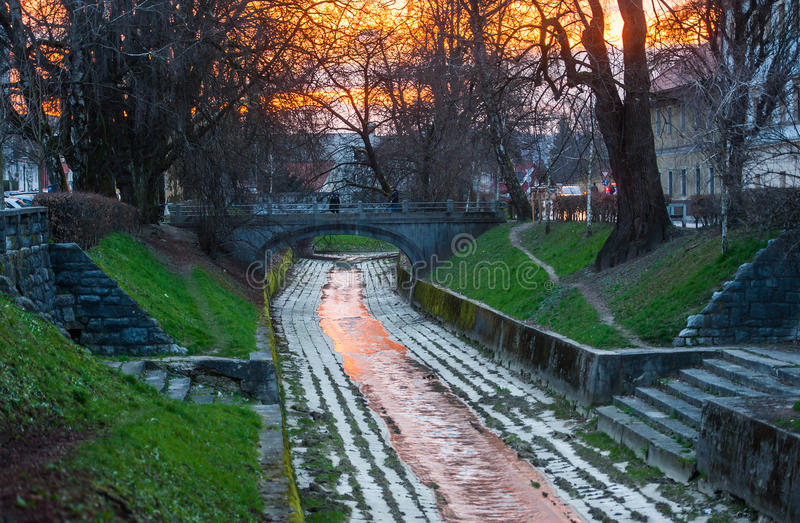 Gradascica river, Ljubljana, Slovenia. Gradascica river in sunset colours, Ljubljana, Slovenia royalty free stock photo
