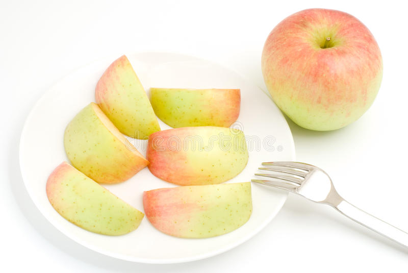 Gradation apple. With fork on a white background stock photos