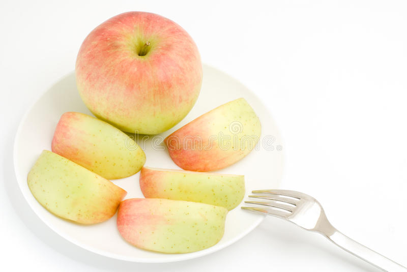 Gradation apple. With fork on a white background royalty free stock image