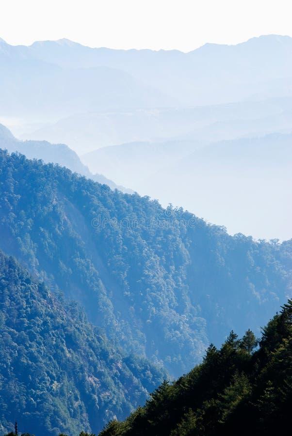 Free Gradation Mountains With Light Fog. Stock Photo - 15666740