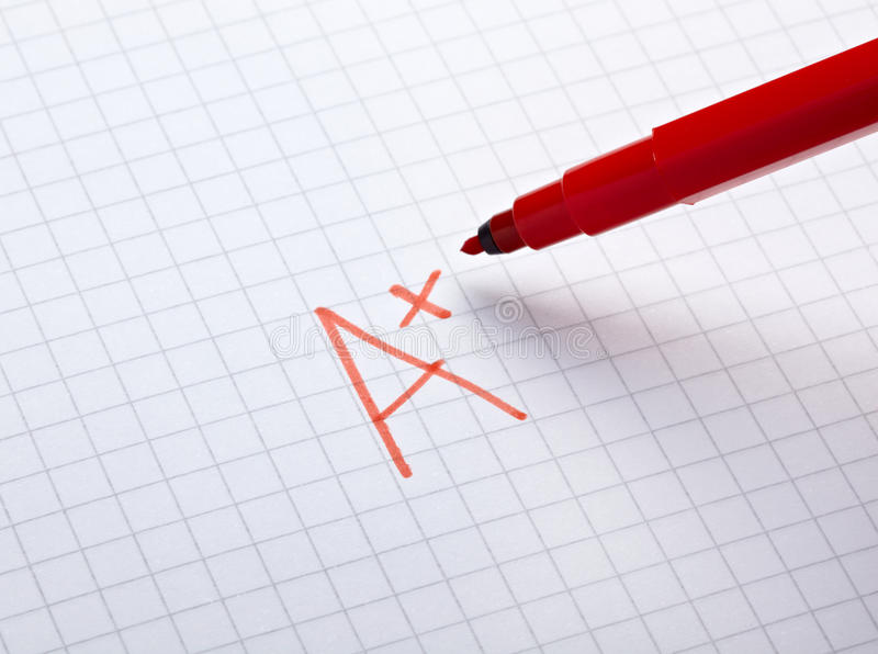 Grade. Close up of grade a and math examination stock photo