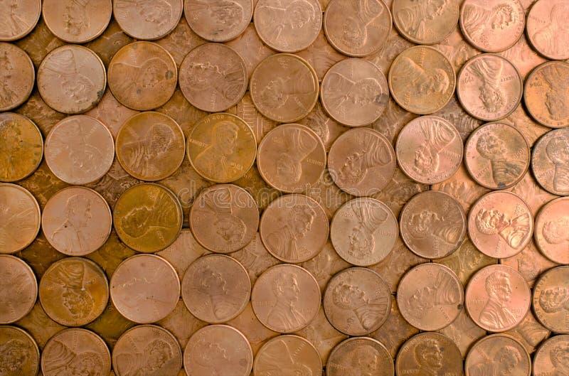 Grade das moedas de um centavo imagem de stock