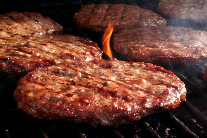 Grade do hamburguer imagens de stock