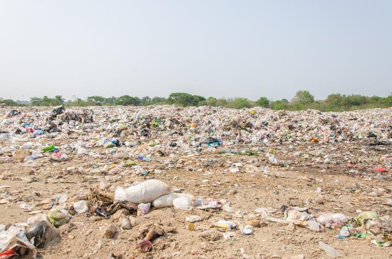Grade loader running landfill waste stock image