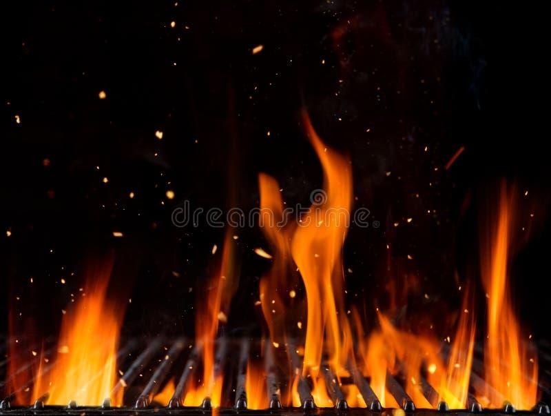 Grade vazia com o fogo isolado no fundo preto ilustração royalty free