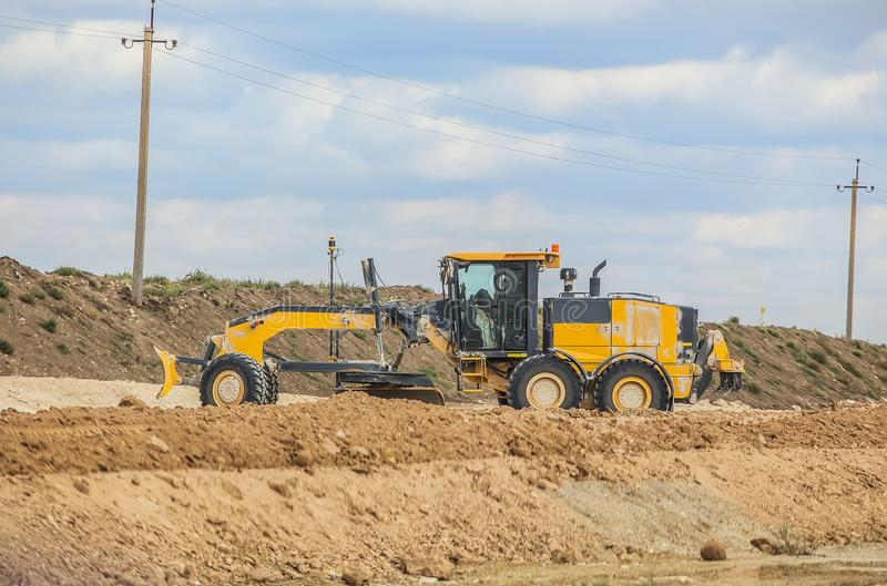 A grader is levelling the road. royalty free stock photos