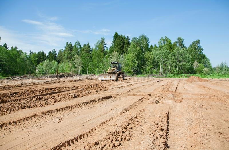 Grader rolls the road on a summer. Day royalty free stock photos