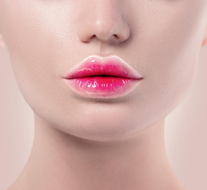 Gradient lipstick trendy lips makeup. Pink and white lips colors, nude make-up sample. Beautiful lips, mouth stock photos
