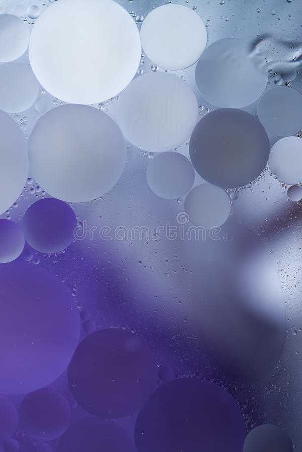 Gradient Purple Oil drops in the water -abstract background.  stock images