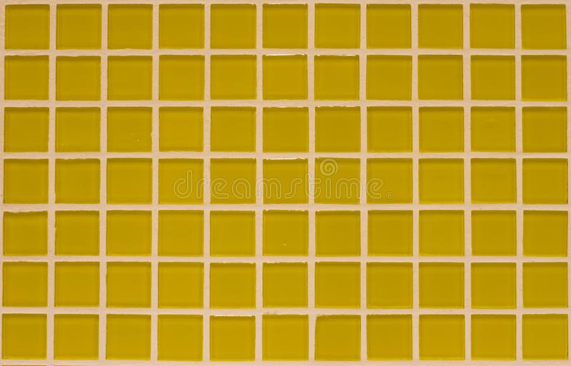 Gradient yellow colored mosaic. Background tiles royalty free stock photos