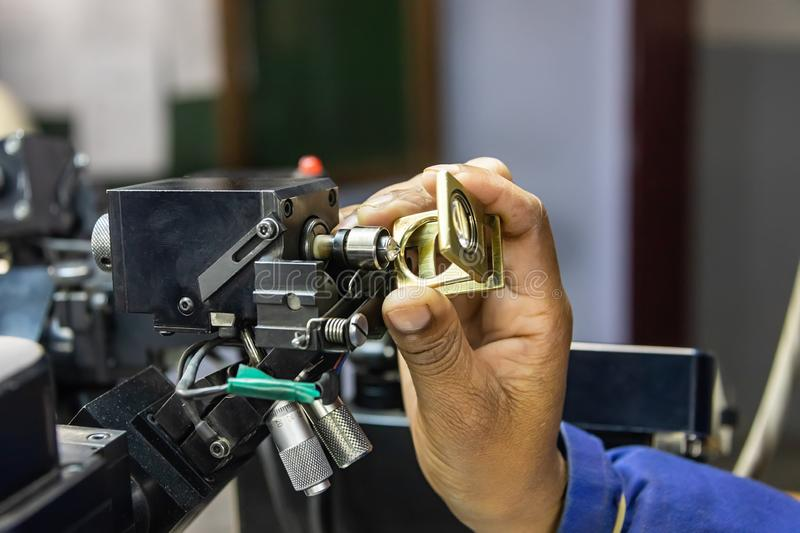 Grading clarity on diamonds. Microscope and magnifying glass, african woman working royalty free stock images