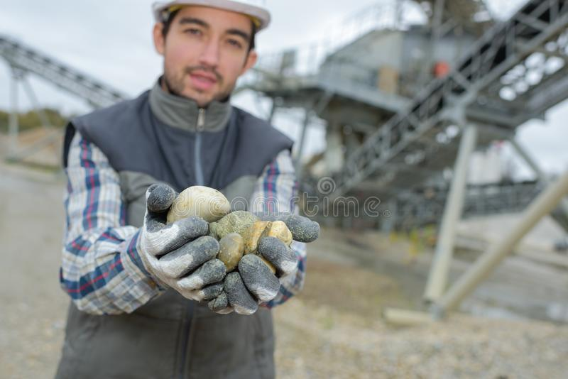 The grading of pebbles. Work royalty free stock image