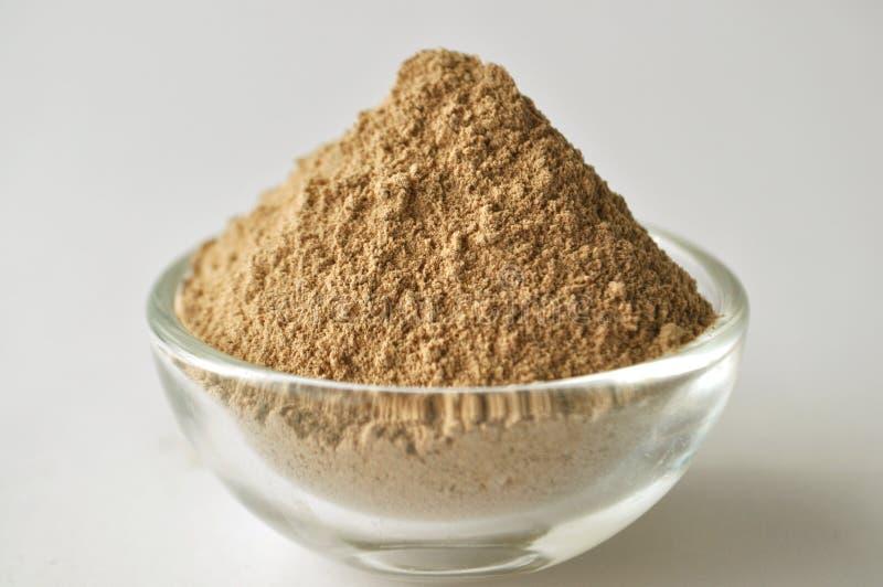 Grado cosmetico della polvere dell'argilla di Rhassoul del marocchino per la maschera di protezione fotografia stock