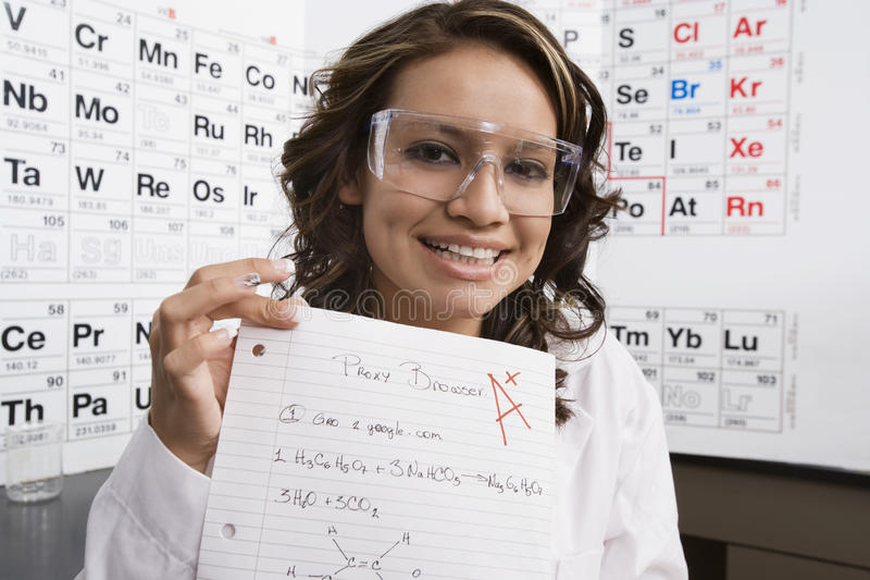 Grado di Showing Off Good dello studente di scienza immagini stock libere da diritti