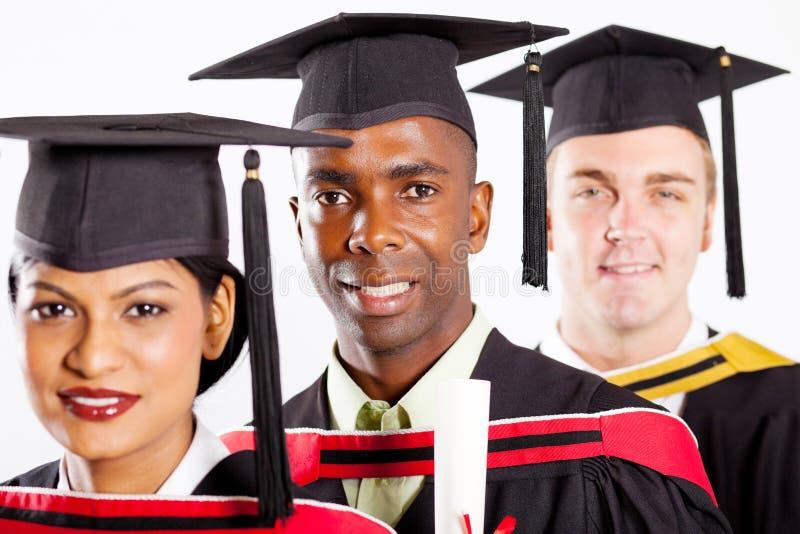 Graduação dos estudantes universitários imagem de stock royalty free