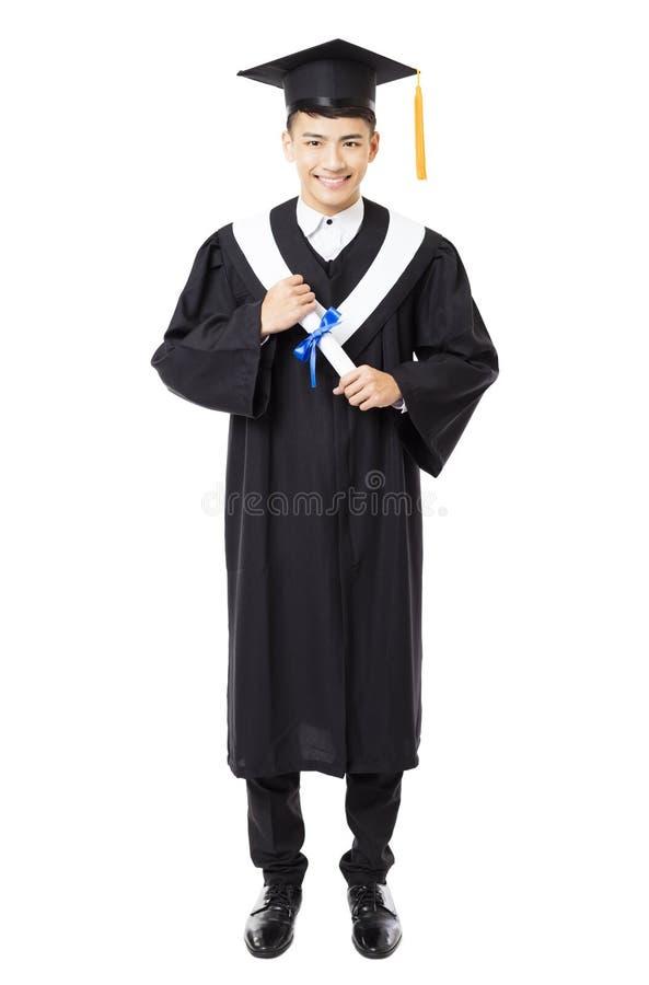 Graduação masculina nova feliz da faculdade foto de stock