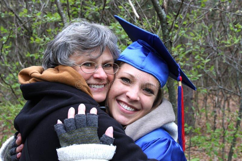 Graduación de las hijas foto de archivo