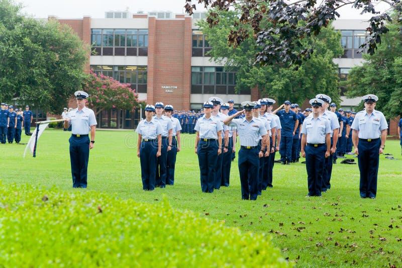 Graduación del guardacostas: Saludo foto de archivo libre de regalías