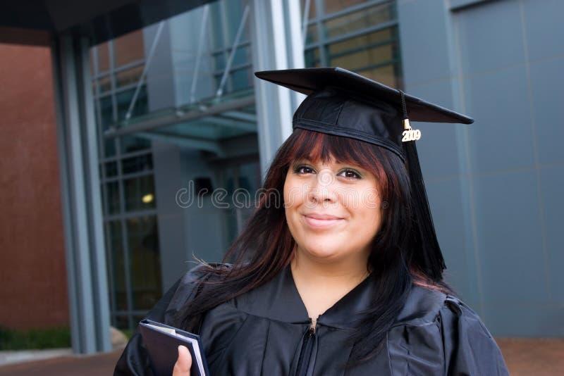 Graduado da mulher nova fotografia de stock royalty free