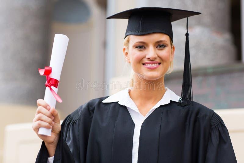 Graduado de la hembra de la universidad foto de archivo libre de regalías