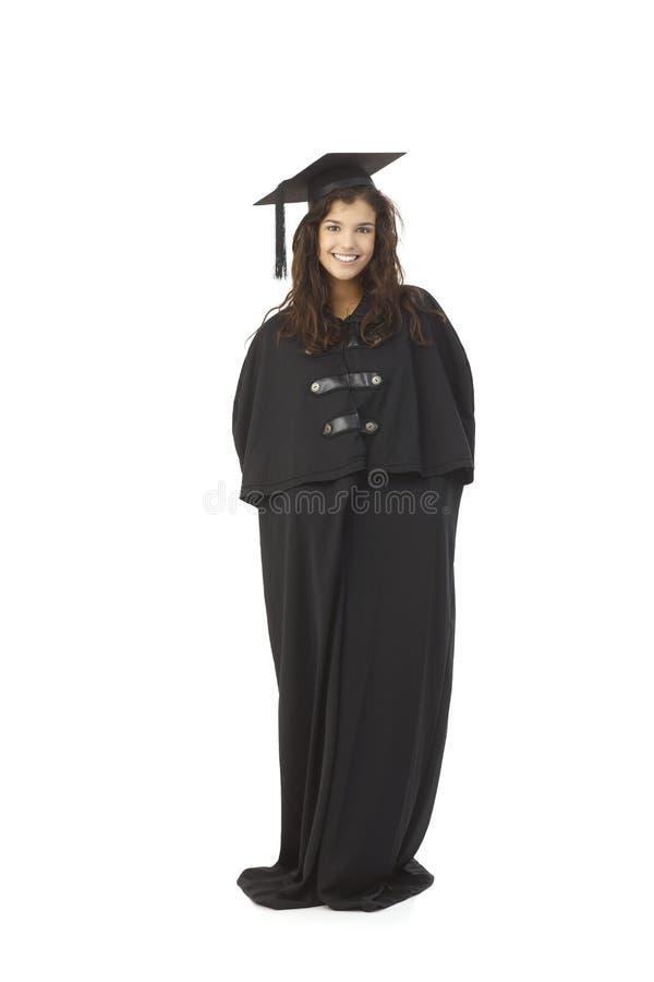 Graduado de la hembra en vestido académico imagen de archivo