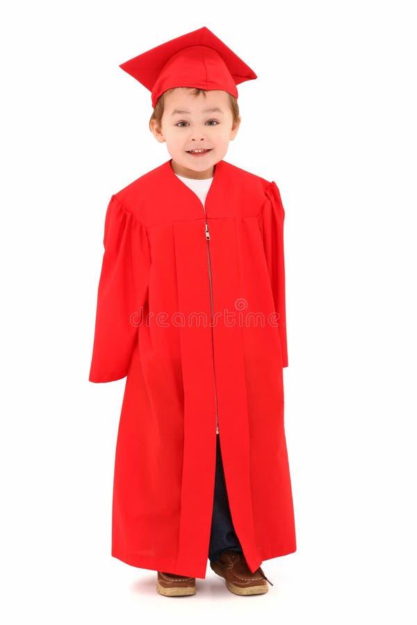 Graduado do pré-escolar no tampão e no vestido foto de stock