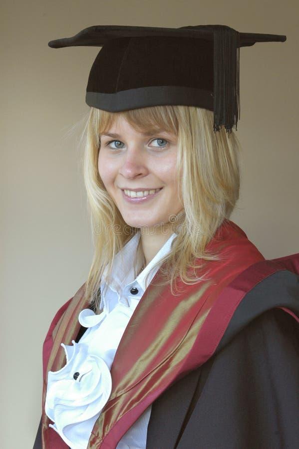 Graduado en casquillo y vestido fotografía de archivo libre de regalías