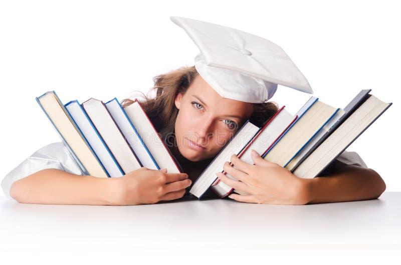 Graduado feliz com lotes dos livros fotos de stock royalty free