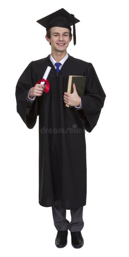 Graduado feliz do homem que guardara seus diploma e livro imagem de stock royalty free