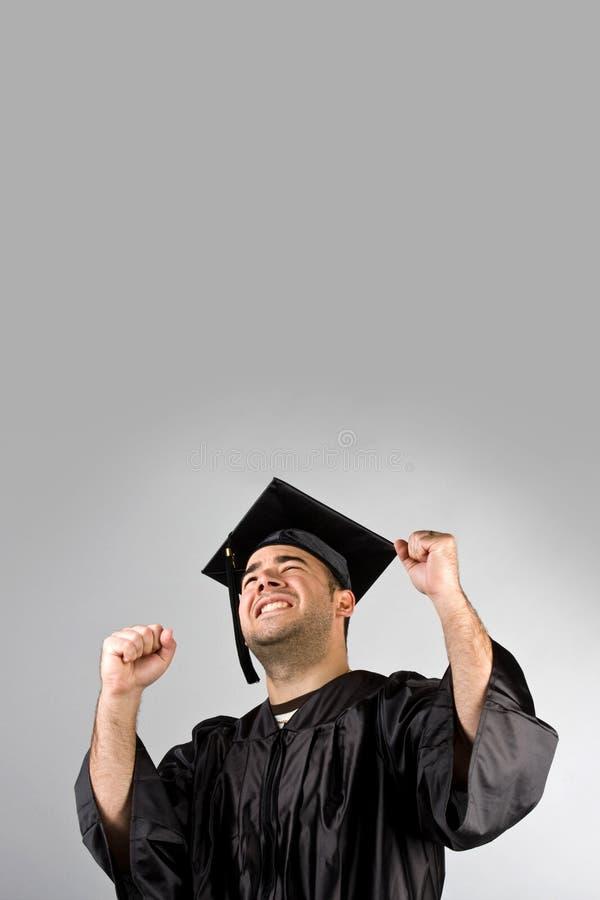 Graduado feliz que comemora imagem de stock royalty free