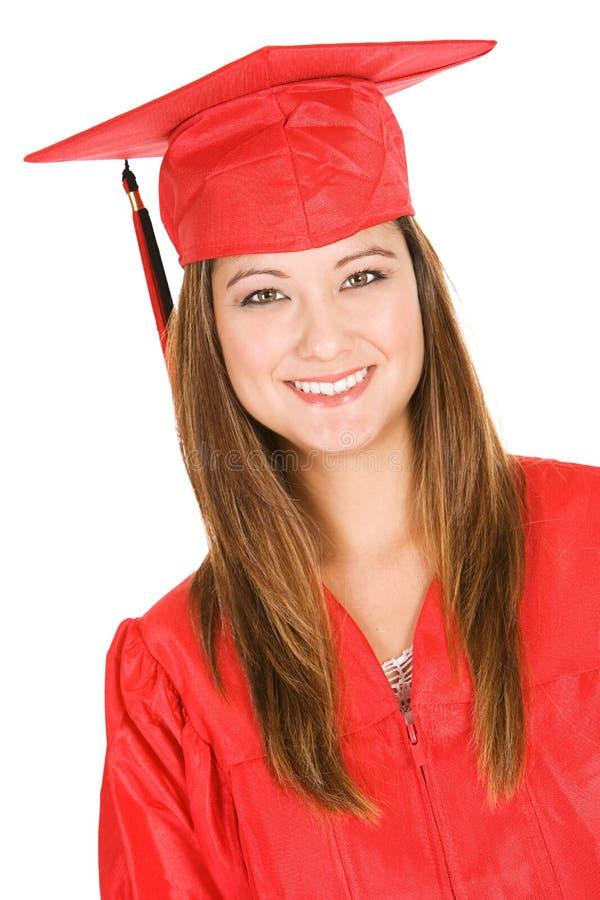 Graduado: Retrato del estudiante In Red Cap y del vestido fotografía de archivo