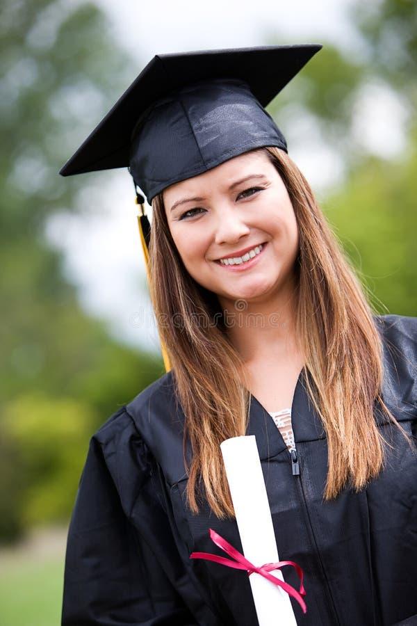 Graduado: Retrato do diploma guardando graduado foto de stock royalty free