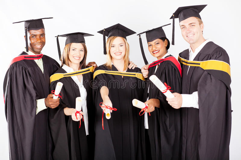 Graduados de la universidad imagen de archivo libre de regalías