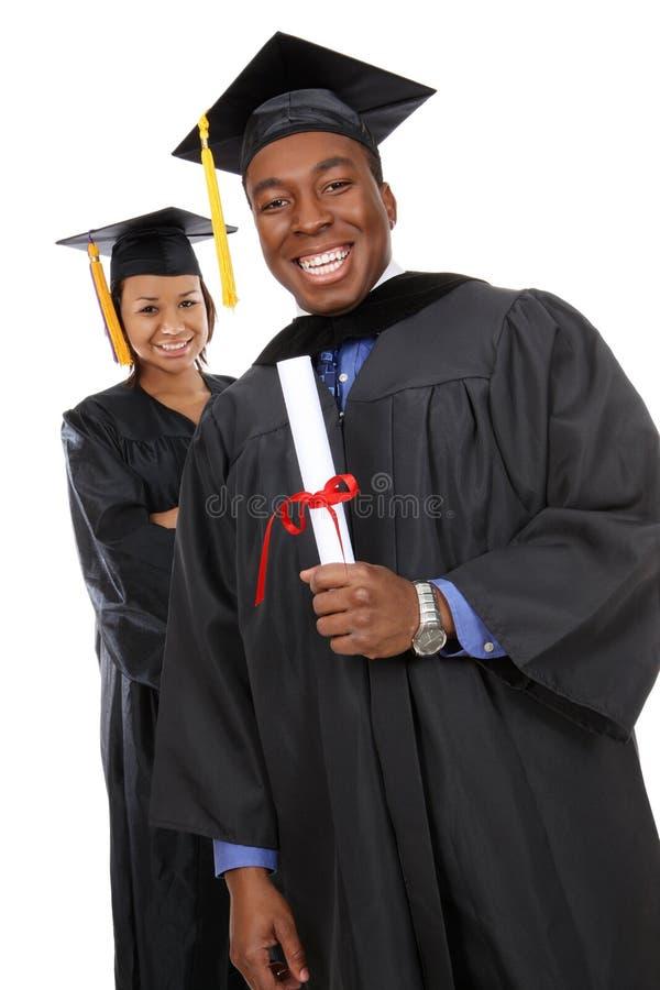 Graduados do homem e da mulher foto de stock royalty free