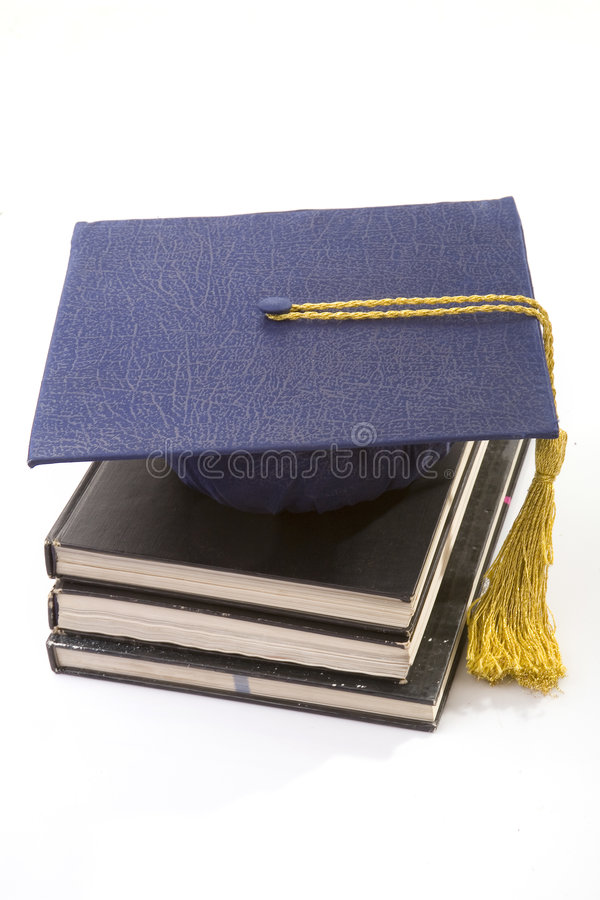 Graduate. The hat and books on white royalty free stock images