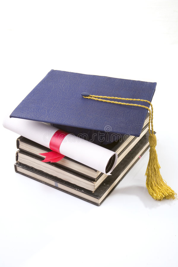 Graduate. Diploma and hat on the white royalty free stock image