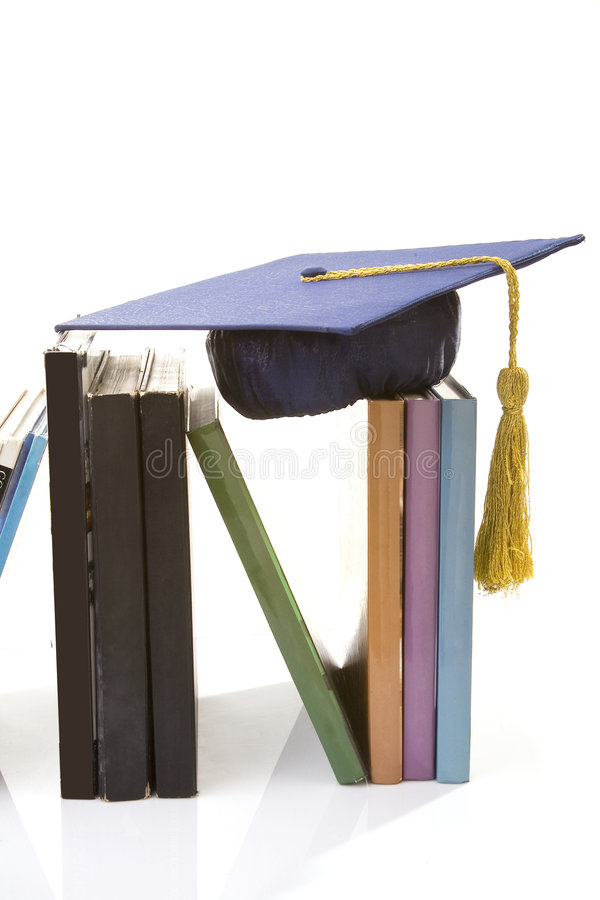 Graduate. Books and hat on the white stock photo