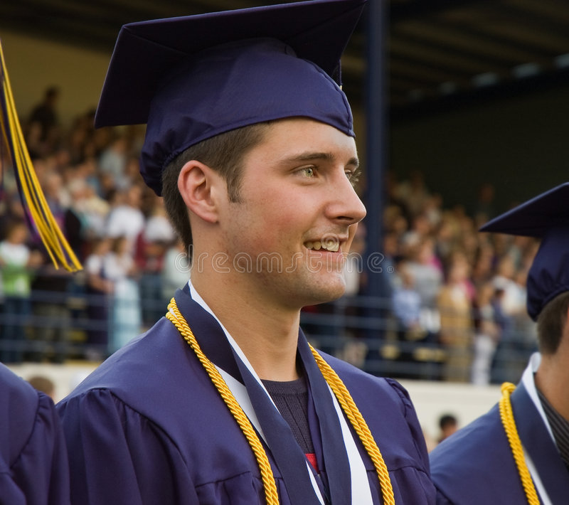 Download Graduate In Cap And Gown With Honor Cords Stock Photo - Image: 9175302