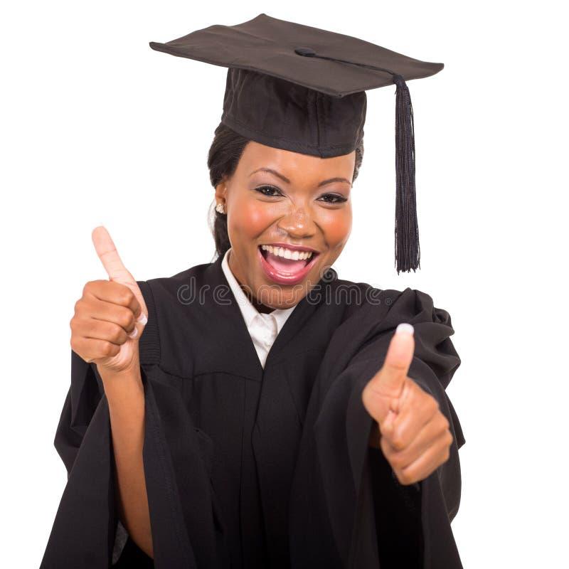 Graduate giving thumbs up stock photos