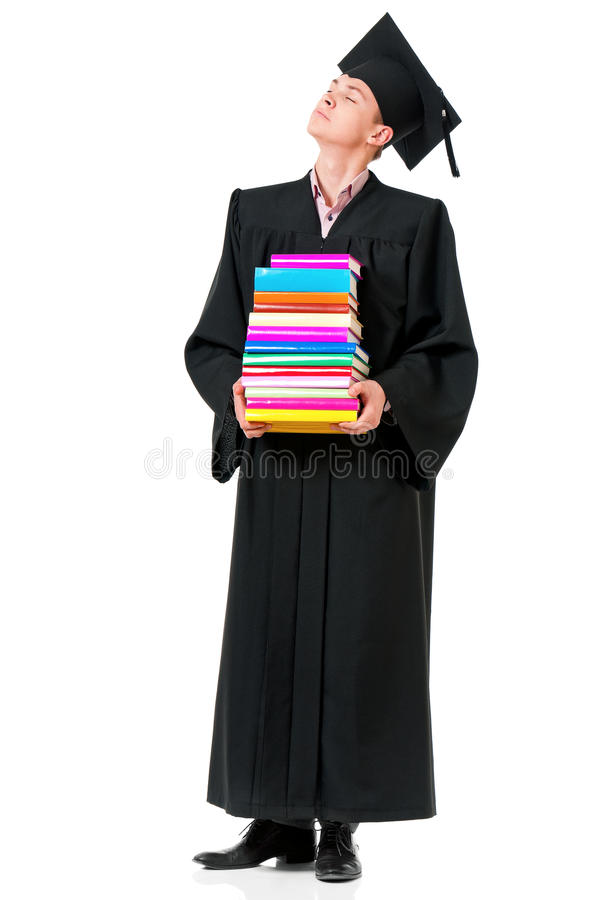 Graduate guy student in mantle with books stock images