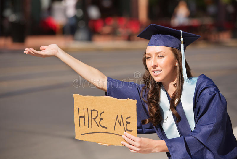 Graduate with Hire Me Sign royalty free stock photography