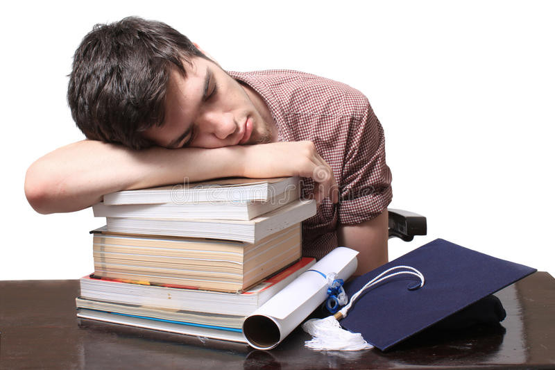 Graduate sleeping on books royalty free stock images