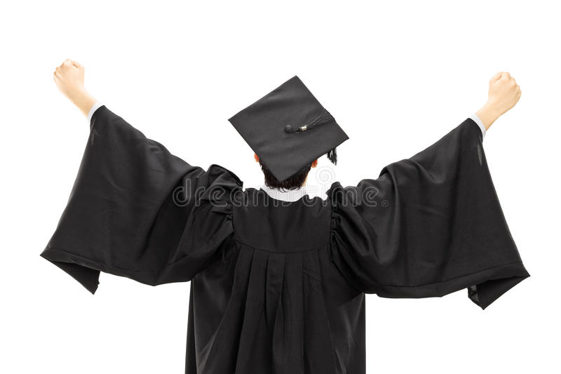 Graduate student in graduation gown with raised hands, rear view. Graduate student in graduation gown with raised hands isolated on white background, rear view royalty free stock image
