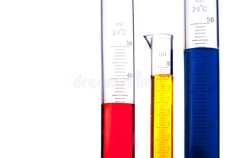 Graduated cylinders of colored chemicals. Three graduated cylinders of different colored chemicals stock photos