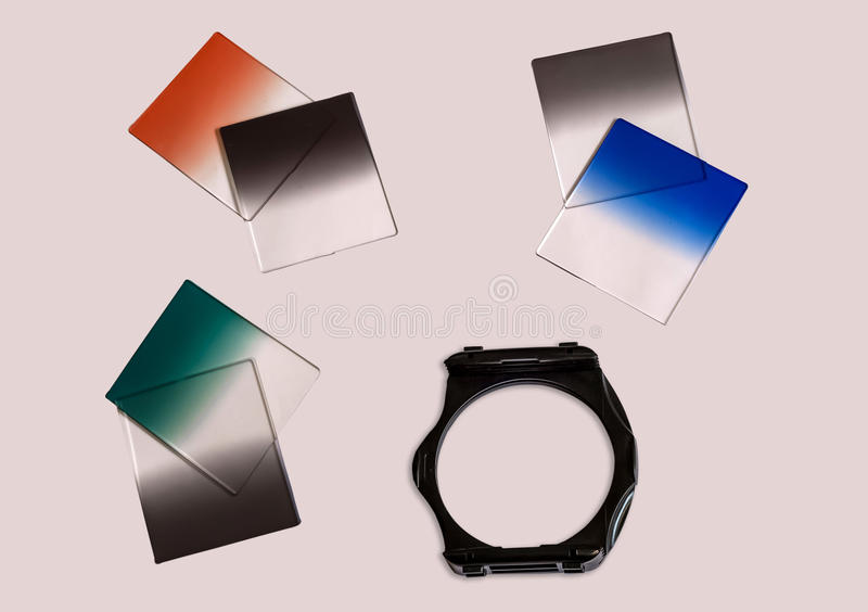 Graduated Neutral density camera filters with holder used for photography isolated. royalty free stock image