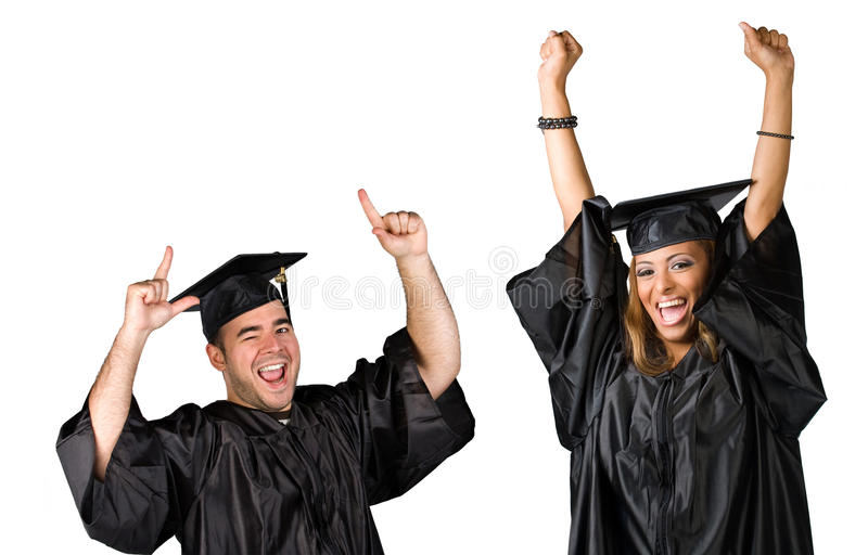 Graduates Celebrating. Two recent graduates posing in their caps and gowns isolated over white stock photography